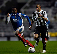 Photo: Jed Wee.<br /> Newcastle United v Portsmouth. Carling Cup. 25/10/2006.<br /> <br /> Newcastle's Kieron Dyer (R) takes on Portsmouth's Manuel Fernandes as he makes a return to action following a lengthy injury lay off.