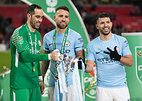Football - 2018 Carabao (EFL/League) Cup Final - Manchester City vs. Arsenal<br /> <br /> Claudio Bravo (Manchester City), Nicolas Otamendi (Manchester City) and Sergio Aguero (Manchester City) with the trophy at Wembley.<br /> <br /> COLORSPORT/DANIEL BEARHAM