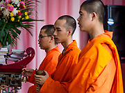 18 SEPTEMBER 2017 - BANGKOK, THAILAND: Buddhist monks chant  at Wat Mangkon Kamalawat, a Chinese Mahayana temple in Bangkok on the last day Hungry Ghost Month. The Ghost Festival, also known as the Hungry Ghost Festival, Zhongyuan Festival or Yulan Festival is a traditional Buddhist and Taoist festival held in Asian countries. According to the Chinese calendar (a lunisolar calendar), the Ghost Festival is on the 15th night of the seventh month. In Chinese culture, the fifteenth day of the seventh month in the lunar calendar is called Ghost Day and the seventh month in general is regarded as the Ghost Month, in which ghosts and spirits, including those of the deceased ancestors, come out from the lower realm. Distinct from both the Qingming Festival (in spring) and Double Ninth Festival (in autumn) in which living descendants pay homage to their deceased ancestors, during Ghost Festival, the deceased are believed to visit the living.     PHOTO BY JACK KURTZ