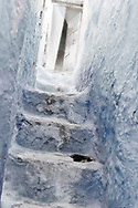 Stone staircase with old, wooden door in the medina of Chefchaouen, Morocco.