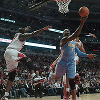 08 November 2010: Denver Nuggets' point forward #7 Al Harrington goes for the reverse layup past Chicago Bulls' small forward #9 Luol Deng during the Chicago Bulls 94-92 victory over the Denver Nuggets at the United Center, in Chicago, Illinois, USA.