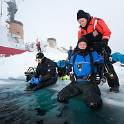 Heloise Chenelot and Richard Morris prepare to dive below the ice of the Arctic Ocean.