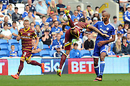 QPR's Grant Hill (c) acrobatically clears from Cardiff City's Frederic Gounongbe. EFL Skybet championship match, Cardiff city v Queens Park Rangers at the Cardiff city stadium in Cardiff, South Wales on Sunday 14th August 2016.<br /> pic by Carl Robertson, Andrew Orchard sports photography.