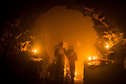 27th November 2014, New Delhi, India. People pray, light candles, incense sticks and ask for wishes to be granted by Djinns in the ruins of Feroz Shah Kotla in New Delhi, India on the 27th November 2014<br /> <br /> PHOTOGRAPH BY AND COPYRIGHT OF SIMON DE TREY-WHITE a photographer in delhi<br /> + 91 98103 99809. Email: simon@simondetreywhite.com<br /> <br /> People have been coming to Firoz Shah Kotla to leave written notes and offerings for Djinns in the hopes of getting wishes granted since the late 1970's. <br /> Feroz Shah Tughlaq (r. 1351–88), the Sultan of Delhi, established the fortified city of Ferozabad in 1354, as the new capital of the Delhi Sultanate, and included in it the site of the present Feroz Shah Kotla. Kotla literally means fortress or citadel. The pillar, also called obelisk or Lat is an Ashoka Column, attributed to Mauryan ruler Ashoka. The 13.1 metres high column, made of polished sandstone and dating from the 3rd Century BC, was brought from Ambala in 14th century AD under orders of Feroz Shah. It was installed on a three-tiered arcaded pavilion near the congregational mosque, inside the Sultanate's fort. In centuries that followed, much of the structure and buildings near it were destroyed as subsequent rulers dismantled them and reused the spolia as building materials.