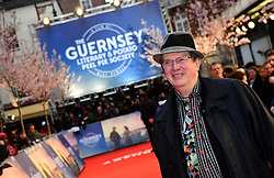 Mike Newell attending The Guernsey Literary and Potato Peel Pie Society world premiere held at Curzon Mayfair, London.
