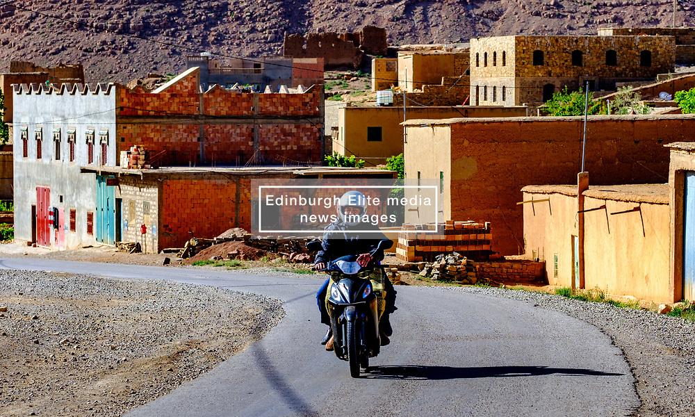 A motocyclist rides through the mountain village of Tamtetoucht, Morocco<br /> <br /> (c) Andrew Wilson | Edinburgh Elite media