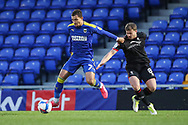 AFC Wimbledon midfielder Cheye Alexander (7) battles for possession with Lincoln City midfielder James Jones (8) during the EFL Sky Bet League 1 match between AFC Wimbledon and Lincoln City at Plough Lane, London, United Kingdom on 2 January 2021.