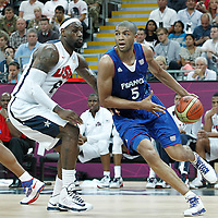 29 July 2012: Nicolas Batum of France drives past USA LeBron James during the 98-71 Team USA victory over Team France, during the men's basketball preliminary, at the Basketball Arena, in London, Great Britain.