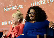 Oprah Winfrey, right, shares a laugh alongside Kari Clark at the dedication of Dick Clark Studios and the Alan Gerry Center for Media Innovation at Syracuse University's Newhouse School, Monday, September 29, 2014, in Syracuse, NY.<br /> (Heather Ainsworth/AP Images for Syracuse University)