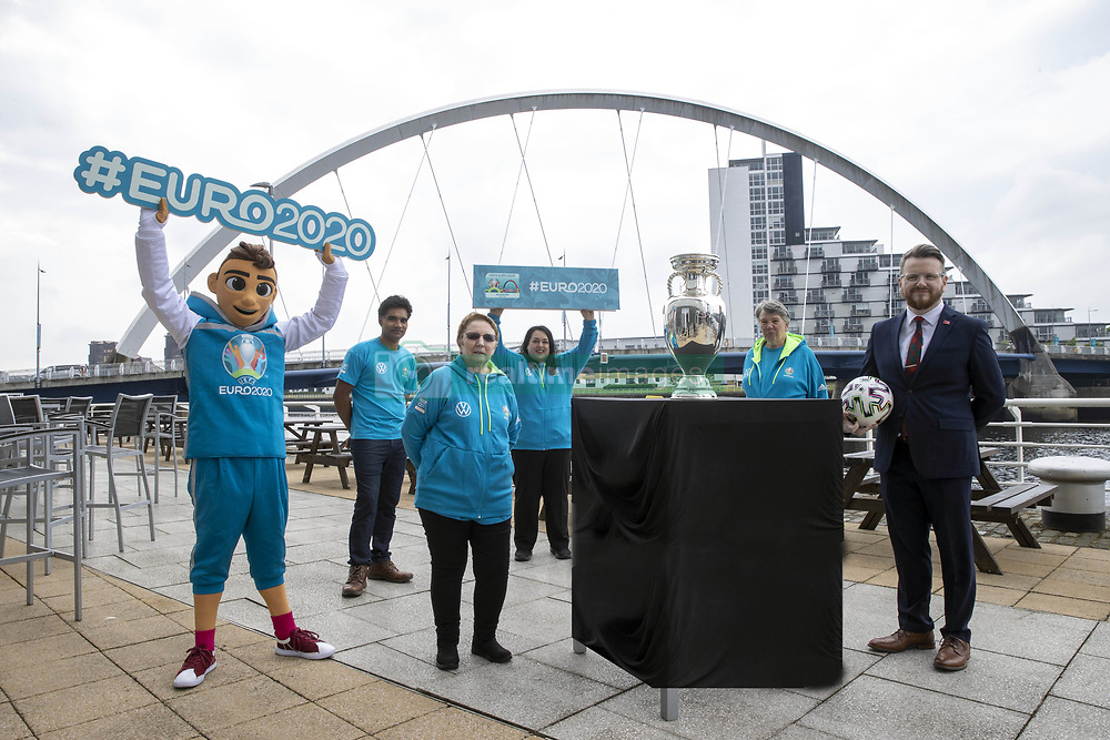 Handout photo provided by JSHPIX of the UEFA Euro 2020 Trophy at Clyde Arc in Glasgow along with Councillor David McDonald and volunteers. Picture date: Thursday June 3, 2021.