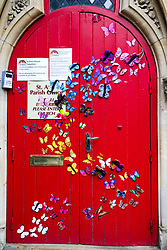 © Licensed to London News Pictures. 07/06/2020. London, UK. Colourful butterflies stuck at the entrance to the St Ann's Church, South Tottenham, north London which has been closed since March 2020 following COVID-19 lockdown. The government is expected to announce that places of worship in England can open for private prayers from 15 June. Photo credit: Dinendra Haria/LNP