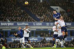 Everton's Michael Keane heads an attempted shot on goal