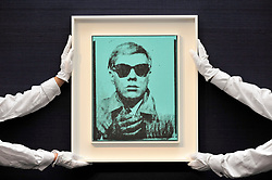 """© Licensed to London News Pictures. 23/06/2017. London, UK. Technicians show """"Self-Portrait"""", 1963-64, by Andy Warhol (estimate GBP5-7m) at the preview of Sotheby's Contemporary Art Sale in New Bond Street.  The auction, which is dominated by Pop art, takes place on 28 June. Photo credit : Stephen Chung/LNP"""