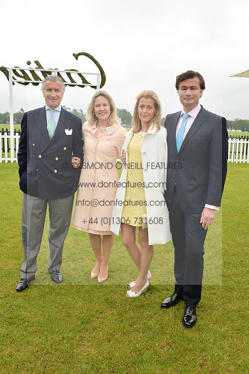 Left to right, ARNAUD & CARLA BAMBERGER and LAURENT & CARINE FENIOU at the Cartier Queen's Cup Polo final at Guard's Polo Club, Smiths Lawn, Windsor Great Park, Egham, Surrey on 14th June 2015