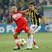 Fenerbahce's Mehmet Topuz (R) and Spartak Moscow's Demy de Zeeuw during their UEFA Champions League Play-Offs, 2nd leg soccer match Fenerbahce between Spartak Moscow at Sukru Saracaoglu stadium in Istanbul Turkey on Wednesday 29 August 2012. Photo by TURKPIX
