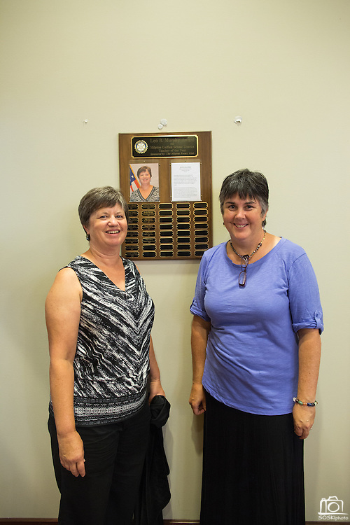 Austa Falconer, left, poses with the award plaque with 2014 MUSD Teacher of the Year Oona Cadorin during the Rotary Club Leo B. Murphy Award for MUSD Teacher of the Year ceremony at the Milpitas Public Library in Milpitas, California, on August 31, 2015. (Stan Olszewski/SOSKIphoto)