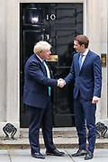 Britain's PM Boris Johnson (L) shakes hands with Austrian chancellor Sebastian Kurz at 10 Downing Street on Tuesday, Feb. 25, 2020. (Photo/Vudi Xhymshiti)