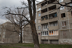 Buildings in the town of Zorinsk damaged by shelling in the recent conflict.