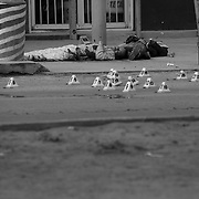 """Two men executed with assault rifles at a taco stand by assassins hired by drug cartels, during what is known as a """"heating up of the plaza"""" in Ciudad Juarez, Mexico..(Credit Image: © Louie Palu/ZUMA Press)"""