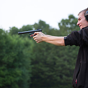 A young man learns firearms technique and gun safety while training under the eye of a retired marine Range Master.