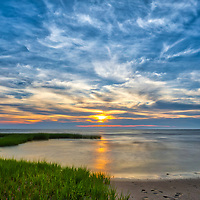 Cape Cod Bay sunset photography at First Encounter Beach in Eastham, Massachusetts. This beautiful Cape Cod Bay beach is located in Eastham, MA and only minutes away from one of Cape Cod's most iconic lighthouses Nauset Beach Light, famous for its logo appearance on the Cape Cod chips.<br /> <br /> Massachusetts Cape Cod fine art photography images are available as museum quality photography prints, canvas prints, acrylic prints or metal prints. Fine art prints may be framed and matted to the individual liking and decorating needs:<br /> <br /> https://juergen-roth.pixels.com/featured/cape-cod-bay-first-encounter-beach-juergen-roth.html<br /> <br /> All New England photos are available for photography image licensing at www.RothGalleries.com. Please contact Juergen with any questions or request. <br /> <br /> Good light and happy photo making!<br /> <br /> My best,<br /> <br /> Juergen