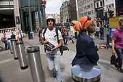 Busy multicultural scene outside Liverpool Street station, London, UK. This is a meeting place for many people on a Sunday intending on heading to the local markets.