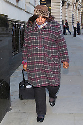 © licensed to London News Pictures. London, UK 15/11/2013. Christine Onade accused of putting a baby in a stationery cupboard on 18 April 2011 at Queen's Hospital, Romford arriving to Nursing and Midwifery Council in central London to give evidence at tribunal on Friday, November 15, 2013. Photo credit: Tolga Akmen/LNP