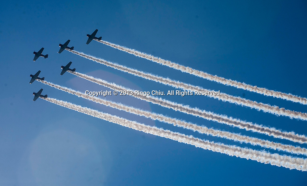 The Geico SkyTypers perform above Lake Michigan during the Chicago Air and Water Show Sundayday, Aug. 18, 2013 in Chicago, Illinois. (Photo by Ringo Chiu/PHOTOFORMULA.com)