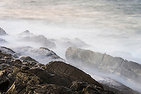 Misty waves breaking over the rocky shoreline,  Tsitsikamma Marine Protected Area, Garden Route National Park, Eastern Cape, South Africa,