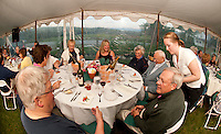 Paul and Renee Speltz, Jennifer Gentry, Janet Englund, Karen Chapman, Mary and Bud Gates and Gary Chapman are served appetizers by Aberdine Donaldson at Moulton Farms Field Dinner overlooking the Ossipee Mountains Tuesday evening.  (Karen Bobotas/for the Laconia Daily Sun)