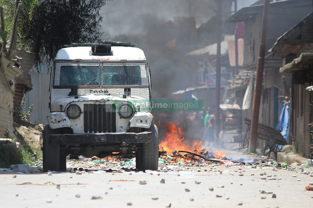 June 15, 2017 - Arwani Kulgam, Jammu and Kashmir, India - Encounter going on between security forces and militants at Arwani area of south Kashmir's Kulgam district .some 50 kilometers from summer capital of Indian occupied Kashmir. 3 militants including top Lashkar Toiba commandar .Junaid Matoo believed to be trapped inside the area. Meanwhile clashes erupted between forces and protesters. (Credit Image: © Aasif Shafi/Pacific Press via ZUMA Wire)