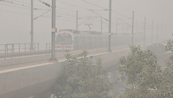 NEW DELHI, Nov. 6, 2016 (Xinhua) -- Photo taken on Nov. 6, 2016 shows a metro train travels among heavy haze at Faridabad on the outskirts of New Delhi, capital of India. Air pollution level has remained high for a week since the Diwali festival by end October in parts of North India. Schools were ordered to remain close till Wednesday and construction or demolition activities were banned for the next five days in New Delhi. Badarpur Power Plant is also closed temporarily to deal with the situation. (Xinhua/Stringer).****Authorized by ytfs* (Credit Image: © Stringer/Xinhua via ZUMA Wire)