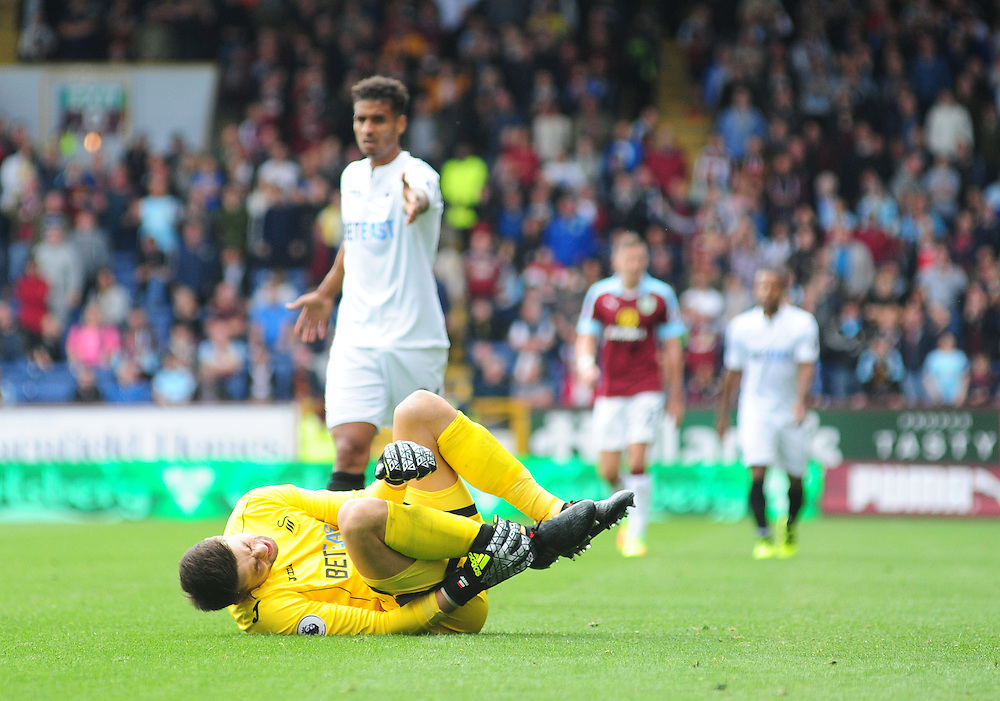 Swansea City's Lukasz Fabianski holds his right ankle after he had tackled Burnley's Scott Arfield<br /> <br /> Photographer Chris Vaughan/CameraSport<br /> <br /> Football - The Premier League - Burnley v Swansea City - Saturday 13th August 2016 - Turf Moor - Burnley<br /> <br /> World Copyright © 2016 CameraSport. All rights reserved. 43 Linden Ave. Countesthorpe. Leicester. England. LE8 5PG - Tel: +44 (0) 116 277 4147 - admin@camerasport.com - www.camerasport.com