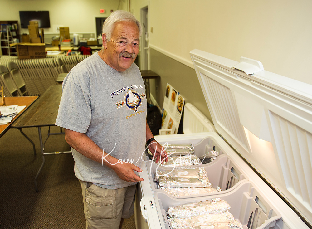 Stu Needleman opens one of the freezers filled with Raspberry Strudel, Ragelach and other treats being sold at the 22nd annual Jewish Food Festival on Sunday at Temple B'nai Israel.  (Karen Bobotas/for the Laconia Daily Sun)