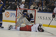 Columbus Blue Jackets center Artem Anisimov (42) slides backwards and sideways towards the goal as St. Louis Blues goalie Jake Allen (34) reaches down to stop his slide during the first period  in a game between the Columbus Blue Jackets and the St. Louis Blues on Friday April 5, 2013 at the Scottrade Center in downtown St. Louis.