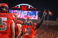 Ameer Abdullah points to the crowd during Nebraska's 45-14 win over Illinois on Sept. 27, 2014. © Aaron Babcock