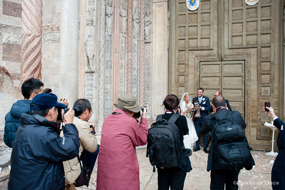 Tourists take photo's of a local wedding in Verona, Italyy