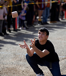 Reese Connelly of Brentwood, Calif. drops to one knee to make the catch of a loaf of Spam during the Spam toss competition at the 22nd annual Spam Festival, Sunday, Feb. 16, 2019, in Isleton, Calif. Spam lovers competed for prizes by presenting their favorite Spam-infused foods, or entering the Spam-eating and Spam-toss contests. (Photo by D. Ross Cameron)