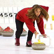 Abagail Barman delivers a stone during a curling match at the Wilmington Ice House. (Jason A. Frizzelle)