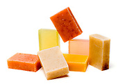Bars of soap of different colour on white background
