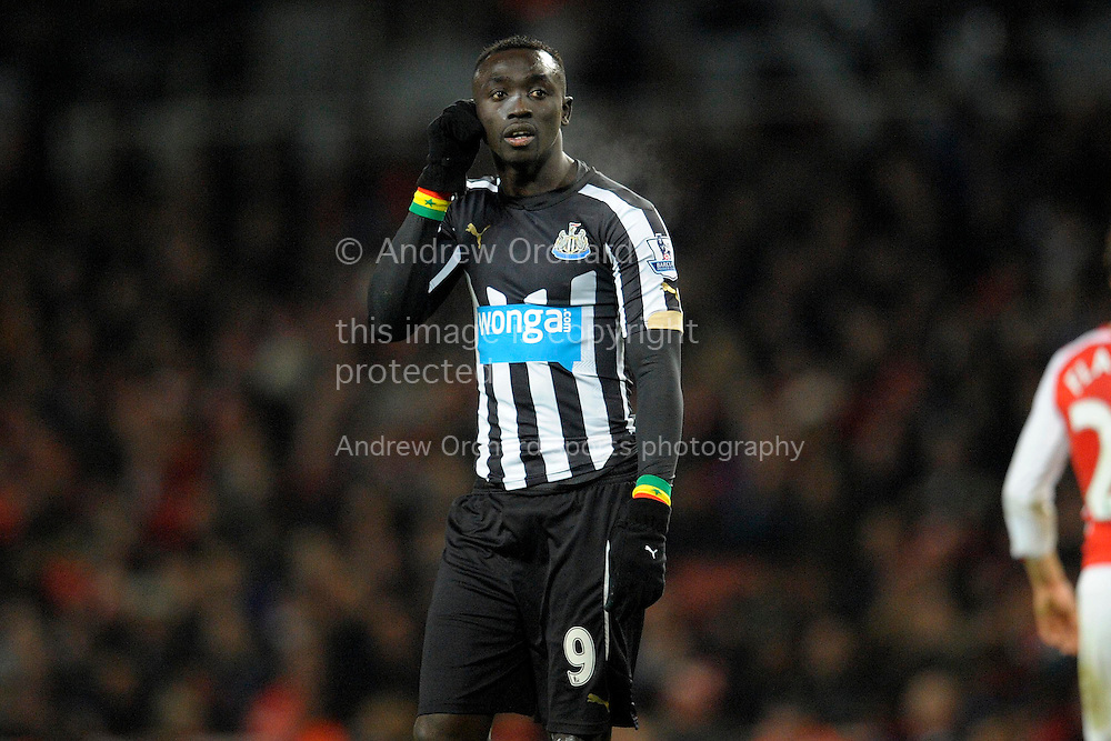 Papiss Demba Cisse of Newcastle United looks on. Barclays Premier league match, Arsenal v Newcastle Utd at the Emirates Stadium in London on Saturday 13th December 2014.<br /> pic by John Patrick Fletcher, Andrew Orchard sports photography.