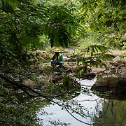 A worker from the adjacent Vulcan Materials Forsest Park quarry rests along the Flint River.