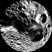 This image from NASA's Dawn mission shows a shadowy view of the northern hemisphere of the giant asteroid Vesta, using pictures obtained during Dawn's last look back. Around the time of Dawn's departure from Vesta in the late summer of 2012, dawn was beginning to creep over the high northern latitudes, which were dark when Dawn arrived in the summer of 2011.
