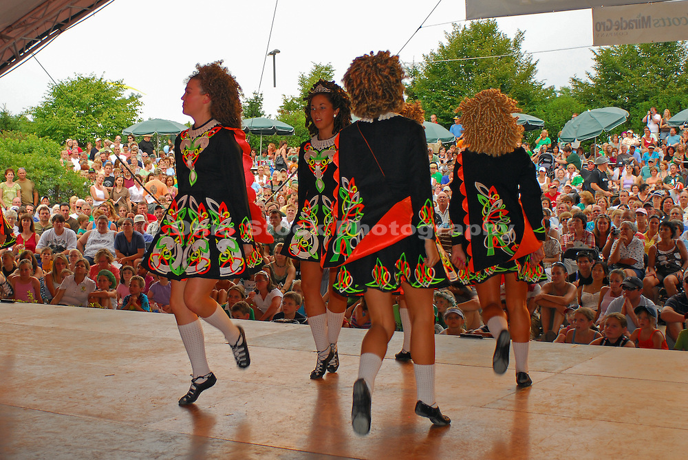 Photo of five girls dancing onstage in front of a large audience at the Dublin Irish Festival in Dublin, Ohio.