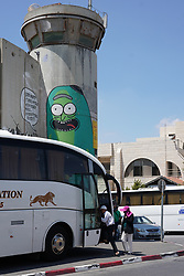 Tourists get into a bus near the wall of separation in Bethlehem. From a series of travel photos taken in Jerusalem and nearby areas. Photo date: Wednesday, August 1, 2018. Photo credit should read: Richard Gray/EMPICS