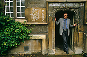 With student graffiti on the classical architecture,  John Gray the political scientist, stands in a doorway wearing a grey jacket and his round-frame glasses in the Quadrangle of Jesus College, Oxford. He is a prominent British political philosopher, author and currently School Professor of European Thought at the London School of Economics. Prior to this he was Professor of Politics at Oxford University. He is a former supporter of the New Right and a regular contributor to the Guardian and the Times Literary Supplement. Also author of many books on political theory. He has written several influential books on political theory, including Straw Dogs: Thoughts on Humans and Other Animals (2003), an attack on humanism, a worldview which he sees as originating in religious ideologies.