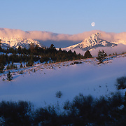 Bridger Mountains at sunrise, with a full moon overhead. Montana