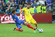 France Forward Antoine Griezmann tackles Romania Defender Razvan Rat during the Group A Euro 2016 match between France and Romania at the Stade de France, Saint-Denis, Paris, France on 10 June 2016. Photo by Phil Duncan.