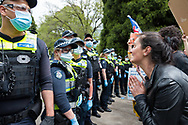 Protesters try to reason with police during the Melbourne Freedom Rally at The Shrine. Premier Daniel Andrews promises 'significant' easing of Stage 4 restrictions this weekend. This comes as only one new case of Coronavirus was unearthed over the past 24 hour and no deaths. (Photo by Dave Hewison/Speed Media)