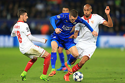 14th March 2017 - UEFA Champions League - Round of 16 (2nd Leg) - Leicester City v Sevilla - Jamie Vardy of Leicester skips between Sergio Escudero of Sevilla (L) and Steven N'Zonzi of Sevilla - Photo: Simon Stacpoole / Offside.